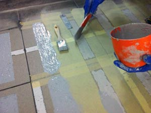 Application of Belzona 5231 with additional aggregate incorporated onto fish market floor