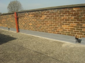 Sealed flashing at parapet wall resulting in long-term roof protection