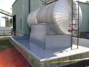 Secondary containment area coated for long-term chemical and corrosion protection